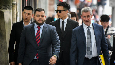 Chinese actor Yunxiang Gao (centre) arrives at court on Wednesday.