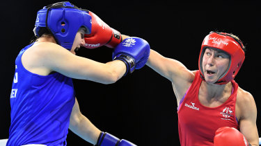 Anja Stridsman sends out a right against Paige Murney of England in the womens 60kg boxing final at the Oxenford Studios on the Gold Coast.
