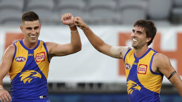 Elliot Yeo congratulates Andrew Gaff on kicking a goal in round 1 at Optus Stadium. The Eagles won't play a fixture on their home turf for some time.