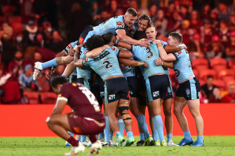 NSW celebrate their series-clinching win in Brisbane as a dejected Felise Kaufusi wonders what might have been.