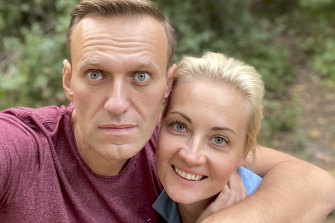 Russian opposition leader Alexei Navalny poses with his wife Yulia pose for a selfie in Germany.