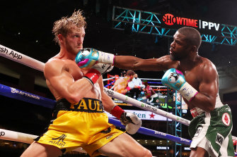 Floyd Mayweather and Logan Paul go at it in the ring.