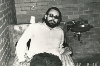 """James """"Jim Jim"""" Brandes, aka Sleepy Jim, was sent from the US to Australia by the Hells Angels to kill policemen Bob Armstrong and Steele Waterman. Seen here after being detained at Melbourne Airport in August 1982."""