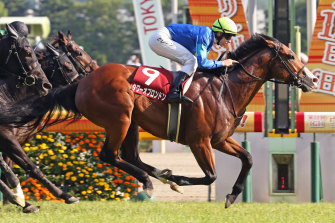 Damian Lane wins the G2 Keio Hai Spring Cup aboard Tower Of London at Tokyo Racecourse