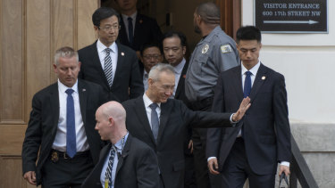 Liu He, Chinese vice premier, salutes as he leaves the trade talks in Washington on Thursday.