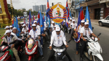 Supporters of Cambodian Prime Minister Hun Sen's People's Party parade in Phnom Penh.