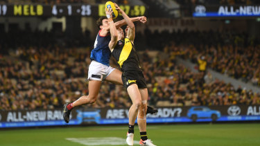 Hit and miss: Marty Hore attempts to spoil a Jack Riewoldt mark.