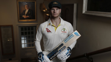 New Don? Steve Smith poses before a portrait of Donald Bradman in the Members Pavilion at Lord's.
