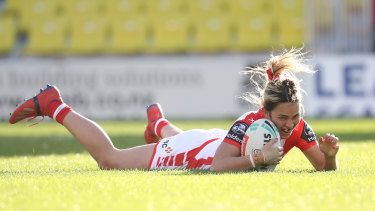 Botille Vette-Welsh crosses for one of her second-half tries for the Dragons.