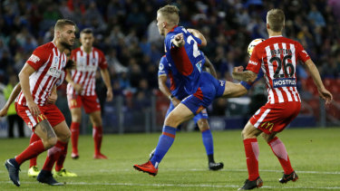 Riley McGree scores his stunner against Melbourne City last season.