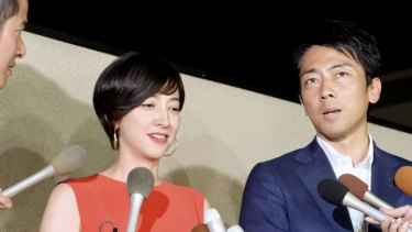 The paternity leave plans of Environment Minister Shinjiro Koizumi, right, who is married to TV personality Christel Takigawa, left, have caused a media stir.