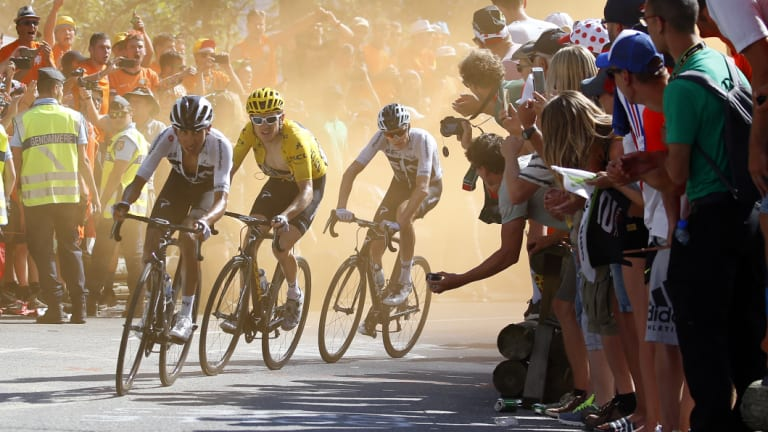 Cheers and jeers from the crowd as, from left, Egan Arley Bernal Gomez, Geraint Thomas and Chris Froome climb Alpe d'Huez.