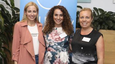 Tech Ready Women founder Christie Whitehil (L) and her program alumni hackers.