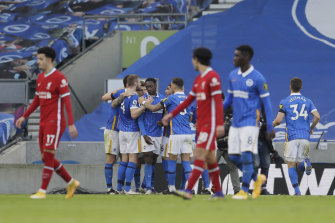 Pascal Gross and his Brighton teammates celebrate his equaliser against Liverpool.