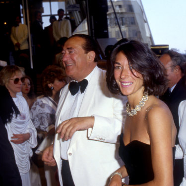 Ghislaine, in black dress, with her father, British media tycoon and fraudster Robert Maxwell, who died in 1991.