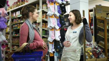 Don't let those smiles fool you: Jessica De Gouw (left) and Laura Carmichael in Network 10's The Secrets She Keeps.