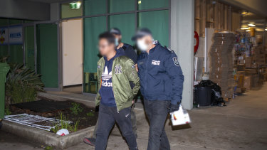 A man was arrested after he attempted to deliver $1 million to a western Sydney diagou store.