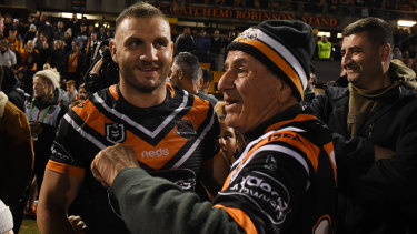 Play it again, Dad ... Peter Farah helped out with the Wests Tigers team song afterwards.