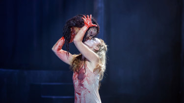 Victorian Opera's Salome, Vida Miknevičiūtė, gets up close and personal with John the Baptist.
