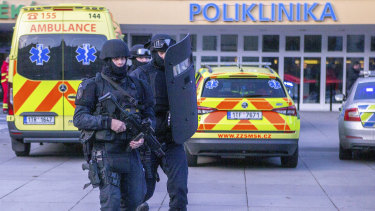 Police outside the Ostrava Teaching Hospital after a mass shooting.
