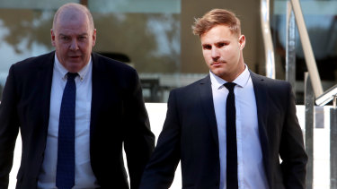 Jack de Belin (right) outside Wollongong Local Court in August.