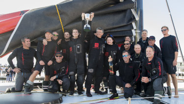 The crew of supermaxi Comanche celebrate line honours in the 2019 Sydney to Hobart.
