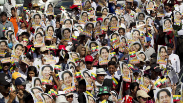 Supporters hold portraits of Myanmar leader Aung San Suu Kyi during a march in Yangoon, Myanmar, on Tuesday.