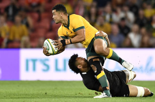 Hunter Paisami of the Wallabies is tackled during the 2020 Tri-Nations match between the Australian Wallabies and the New Zealand All Blacks at Suncorp Stadium.