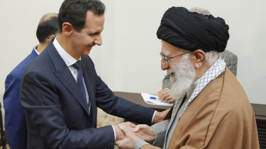 Syrian President Bashar Assad shakes hands with Iranian Supreme Leader Ayatollah Ali Khamenei before their meeting in Tehran on Monday.