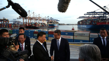Xi Jinping and Kyriakos Mitsotakis visit the COSCO container terminal at Piraeus port in Athens.