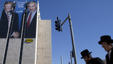 "An election campaign billboard shows Israeli Prime Minister Benjamin Netanyahu, right, and US President Donald Trump in Jerusalem. Hebrew on the billboard reads: ""Netanyahu is a different league."""