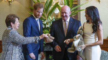 Australian Governor-General Sir Peter Cosgrove  and his wife Lady Cosgrove present a toy kangaroo and a pair of small ugg boots to Prince Harry and his wife Meghan for Baby Sussex, now Archie Harrison Mountbaten-Windsor.