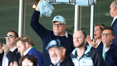 Prime Minister Scott Morrision cheers on the Cronulla Sharks on Saturday.