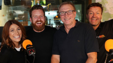 "Triple M's Brisbane breakfast show team (left to right): Robin Bailey, new recruit Nick Cody and Greg ""Marto"" Martin with former presenter Lawrence ""the Moonman"" Mooney."