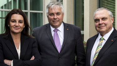 Senator Jacqui Lambie with Centre Alliance senators Rex Patrick and Stirling Griff at Parliament House.