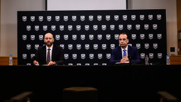 Former NRL chief executive Todd Greenberg and ARL Commission chairman Peter V'landys announce the suspension of the NRL on March 23.