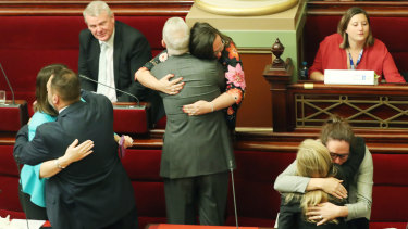 Victorian MPs embrace after the Voluntary Assisted Dying Bill passed the upper house.