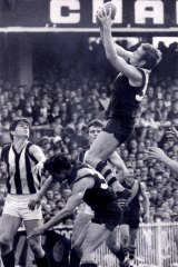 Son of a gun: Tom Green's father Michael flies high for Richmond in 1969.