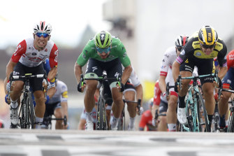 Top shelf: Caleb Ewan, left, Peter Sagan, centre, and Dylan Groenewegen, right, fight it out at the Tour de France.