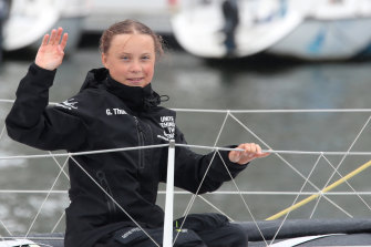Greta Thunberg waves to her supporters on her arrival in New York aboard the zero-emissions yacht Malizia II.