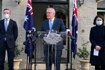 Prime Minister Scott Morrison, flanked by NSW Treasurer Dominic Perrottet and Premier Gladys Berejiklian.