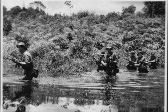 Australian infantrymen of the 1st Battalion, Royal Australian Regiment, newly arrived in Malaya are undergoing rigorous training at Kota Tinggi in South Malaya.