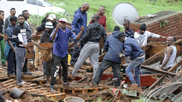 Rescue workers search for victims in a collapsed building near Durban, South Africa.