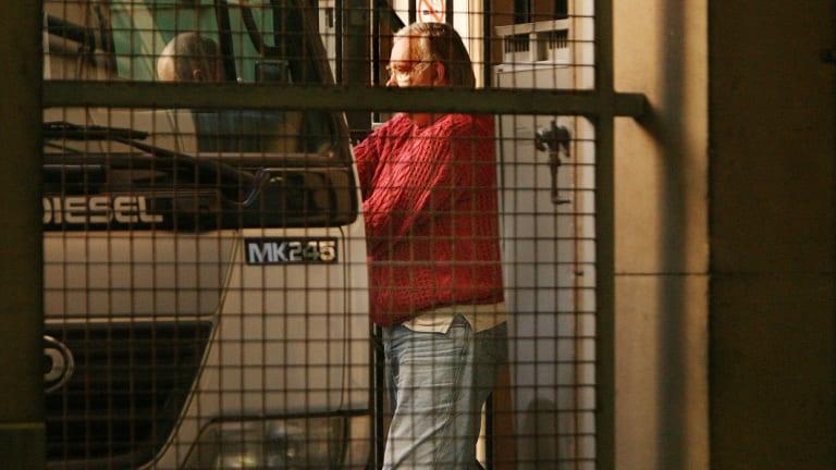 John Denham is escorted from court in 2008.