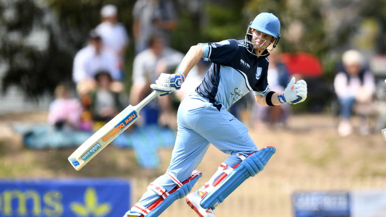 He's back: Steve Smith runs between wickets for Sutherland against Mosman at Glenn McGrath Oval.
