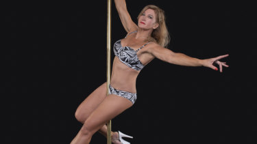 Debra Lynch shows off her pole-dancing skills.