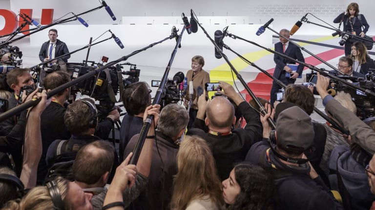 German Chancellor Angela Merkel addresses the media on Thursday.