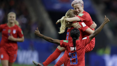 United States' scorer Samantha Mewis lifts her teammate Megan Rapinoe as she celebrates her side's fourth goal.