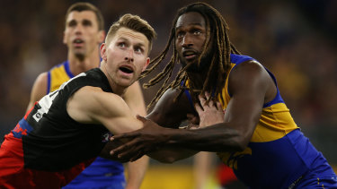 Essendon's Shaun McKernan tussles with Eagle Nic Naitanui.