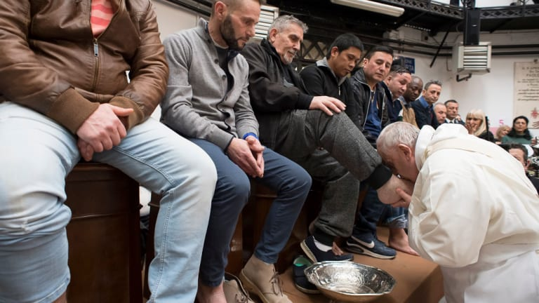 Pope Francis washes the feet of inmates during his visit to the Regina Coeli detention centre in March.